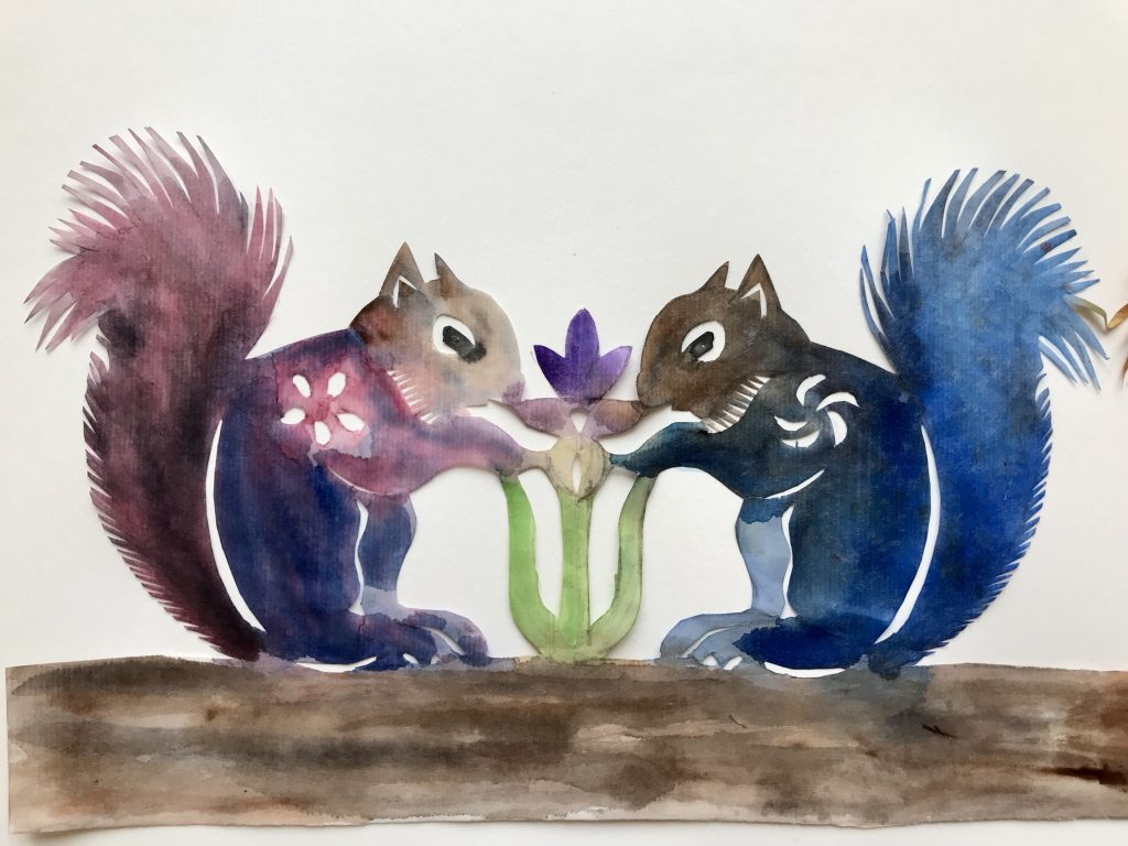 Watercolor papercut design of two squirrels facing each other